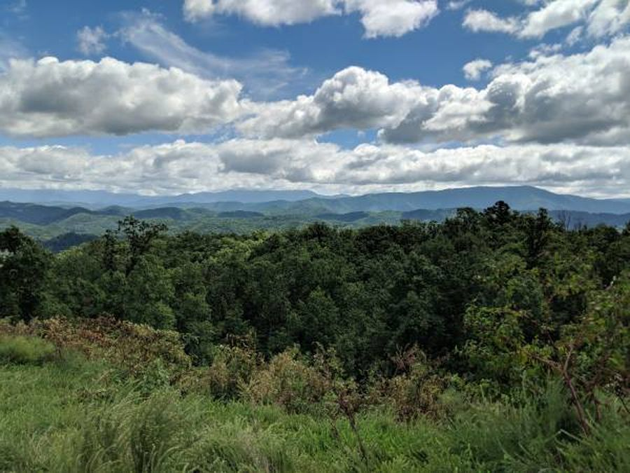Lot 104 Laurel Cove Trail in The Summit on Bluff Mountain offers a tremendous mountain view