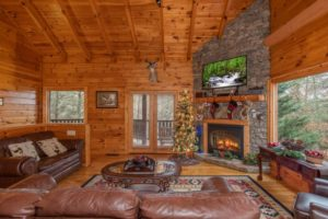 Blue Moose Lodge is a four bedroom cabin in luxurious Cedar Falls just outside of Pigeon Forge. The cabin is located a very short walk to the community pool and amenities. It also features a theater room, huge family room area, private hot tub area, and much more