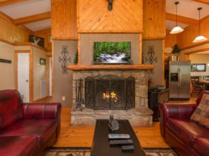 Mountain Memories is a four bedroom recently remodeled chalet in Gatlinburg. It offers a cozy wood burning fireplace, mountain view, tram view, theater room, game room, and a convenient Gatlinburg location