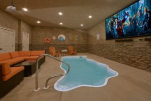 Otter Springs Pool Cabin is a two bedroom rental cabin in Pigeon Forge with an indoor pool, theater, and great location convenient to Pigeon Forge