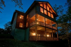 Pinnacle Vista is a six bedroom luxury rental cabin in Pigeon Forge with a private mountain view, theater room, large kitchen, and other quality amenities